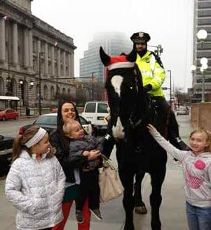 Mounted police officer and children