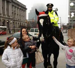 mounted police with children