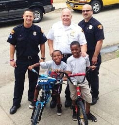Officers and children with bikes