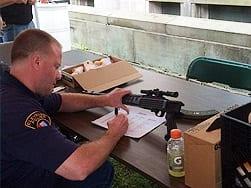 Policeman at handgun buyback