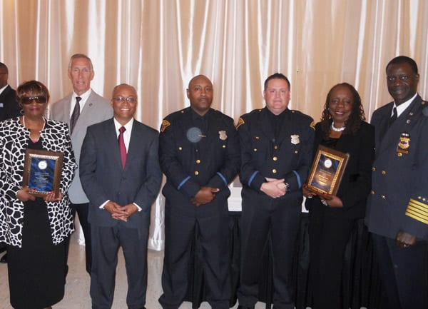 The Cleveland Police Foundation 4th District Award winners proudly display their plaques. L to R:  Elaine Gohlstin, Safety Director Michael McGrath, CPF President Thomas Stone, PO Carl Perkins, Det. Kevin Callahan, Debra Lewis-Curlee, and Chief Calvin Williams.