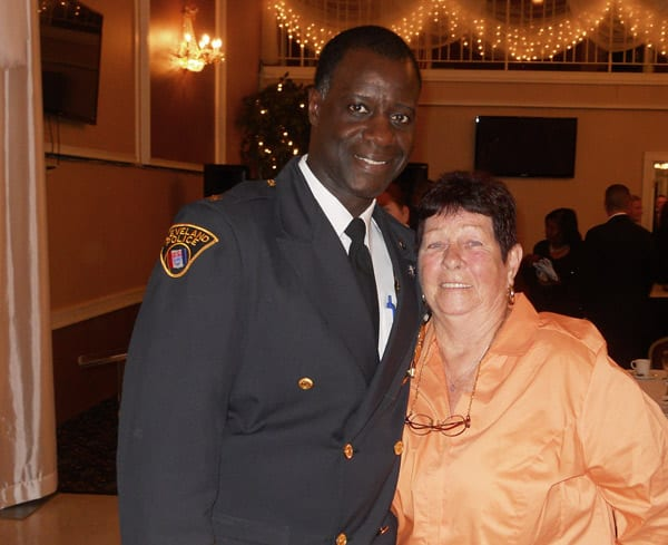 Cleveland Police Chief Calvin Williams thanks Betty Rodes for her support and for attending the award presentations.