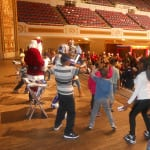 """The boys and girls attending the P.A.L. party join Santa, and """" The Rockin Robots"""" on stage for a dance session that seemed to go on forever."""