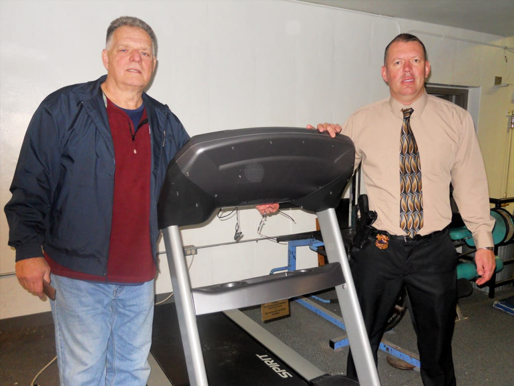 Cleveland Police Foundation Community Partnership Coordinator, Bob Guttu on the left, and Second District Detective, Bill Gonzalez, stand by the new addition to the Second District gym.