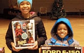 Children with holiday presents from PAL