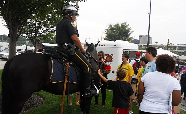 Mounted policemen with community