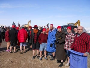 """Team """" Cleveland Policicles """" await their turn to take the plunge into Lake Erie"""