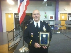 Lieutenant Michael Butler with his Cleveland Police Foundation Community Service Award.