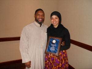 Akeesha Abdullah poses with her husband and her Community Service Award.