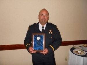 Captain John Sotomayor proudly displays his award.