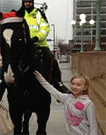 Girl with officer and horse