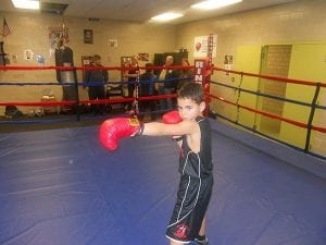 Boxing trainee Jonah Boyles shows his style in the Estabrook Recreation Center's donated boxing ring.