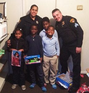 Members of the Davis family pose with PO Anna Mercado and Sgt. Tim Higgins. L to R: Daeshauna, Age 7; Deangelo, Age 9; Tyshawn, Age 8; and Antwjuan, Age 11.