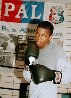 Teen wearing boxing gloves - part of the PAL program