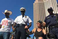 Police and protesters at the RNC