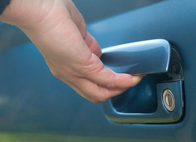 male hand opening car door