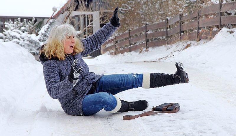 Woman falling on ice