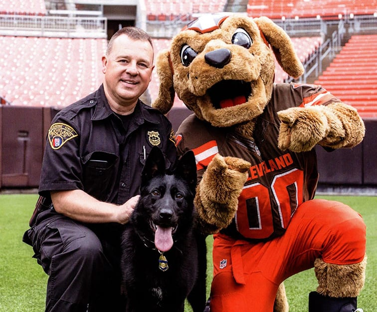 A K-9 Officer and his handler with the Browns mascot