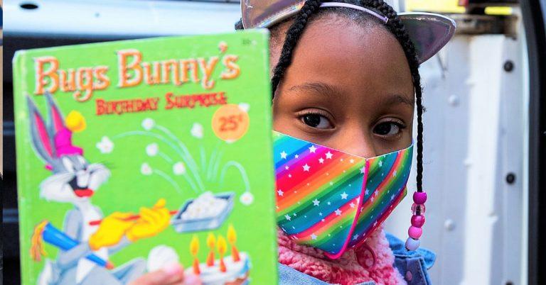 girl with bugs bunny book